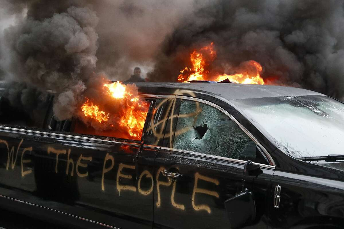 A parked limousine burns during a demonstration after the inauguration of President Donald Trump, Friday, Jan. 20, 2017, in Washington. Protesters registered their rage against the new president Friday in a chaotic confrontation with police who used pepper spray and stun grenades in a melee just blocks from Donald Trump's inaugural parade route. Scores were arrested for trashing property and attacking officers. (AP Photo/John Minchillo)