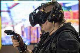 LEIPZIG, GERMANY - JANUARY 14: A player with virtual reality glasses attends at the three-day Dreamhack 2017 gaming festival on January 14, 2017 in Leipzig, Germany. The Dreamhack festival brings together thousands of video-gaming enthusiasts from across Europe for large-scale LAN competitions, cosplay and e-sports.