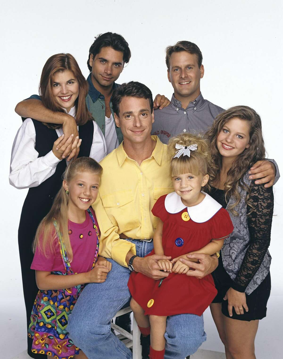 UNITED STATES - SEPTEMBER 14: FULL HOUSE - Season Seven - Gallery - 9/14/93, Pictured, back row: Lori Loughlin (Rebecca), John Stamos (Jesse), Dave Coulier (Joey); bottom row: Jodie Sweetin (Stephanie), Bob Saget (Danny), Mary Kate Olsen (Michelle), Candace Cameron (D.J.), (Photo by Bob D'Amico/ABC via Getty Images)