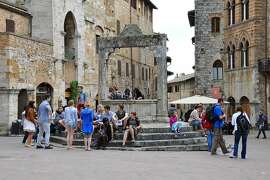 Today's tourists hang out at San Gimignano's Piazza della Cisterna, by same well that locals used a thousand years ago.