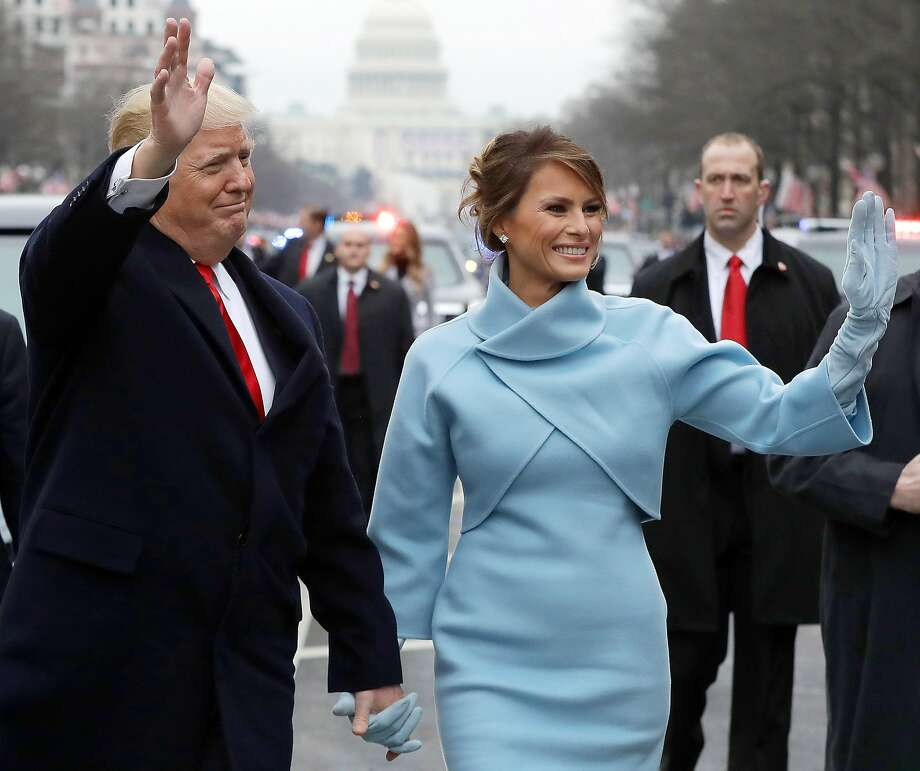 President Donald Trump waves to supporters as he walks the parade route with first lady Melania Trump after being sworn in at the 58th Presidential Inauguration. Photo: Pool, Getty Images