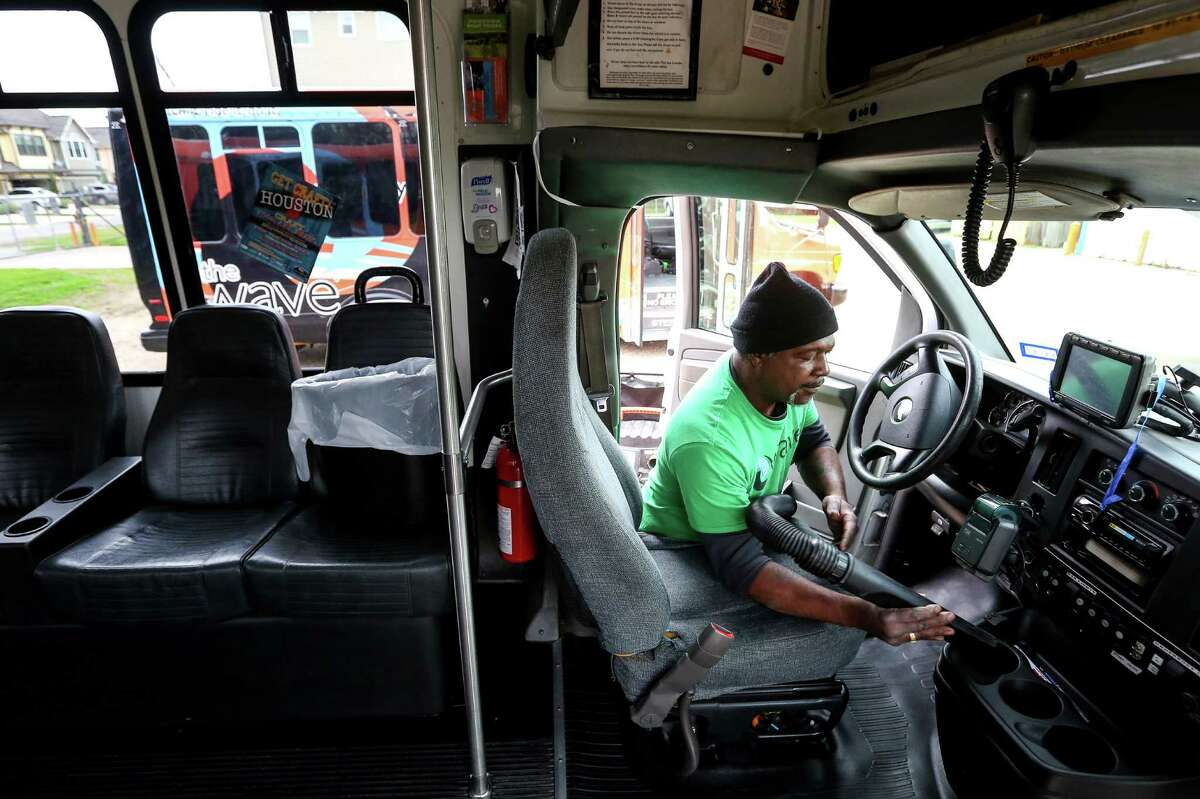 Jessie Jackson, a mechanic's helper at the Houston Wave, details a bus on Jan. 4. Three Wave buses will operate a shuttle system through Midtown during Super Bowl LI actitivies.
