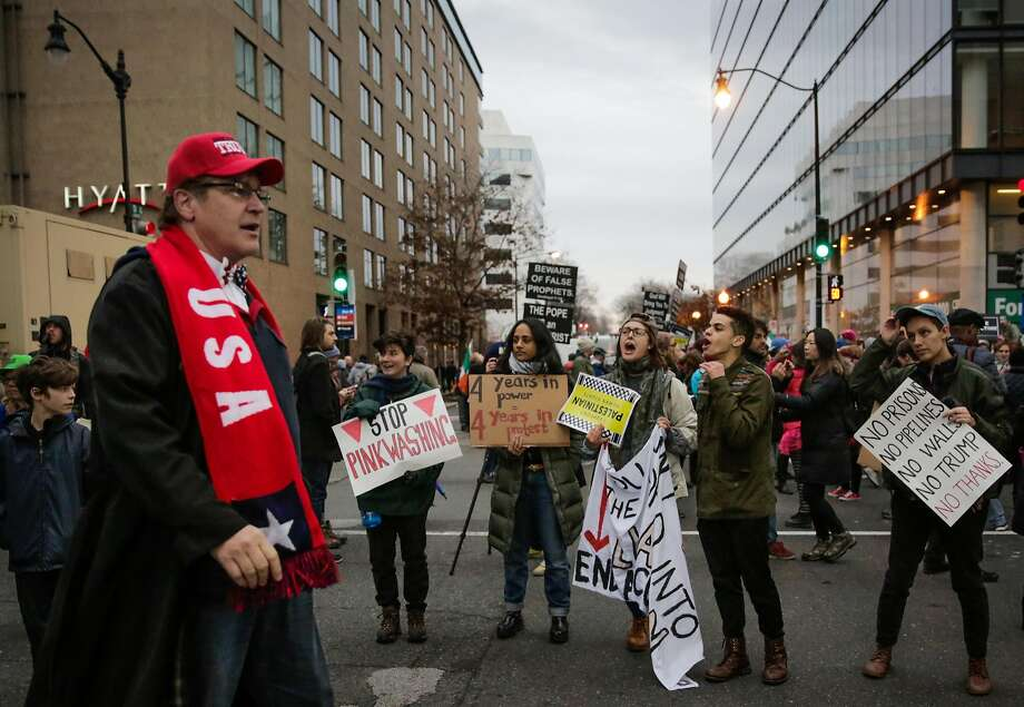 Protesters yell at Trump supporter West Walker (left) of Stockton, California as he makes his way to Donald Trump's Presidential inauguration on D Street in Washington, D.C., on Friday, Jan. 20, 2017. Photo: Gabrielle Lurie, The Chronicle