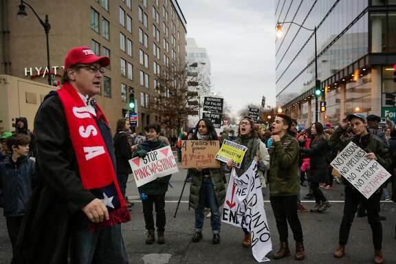 Protesters yell at Trump supporter West Walker (left) of Stockton, California as he makes his way to Donald Trump's Presidential inauguration on D Street in Washington, D.C., on Friday, Jan. 20, 2017.