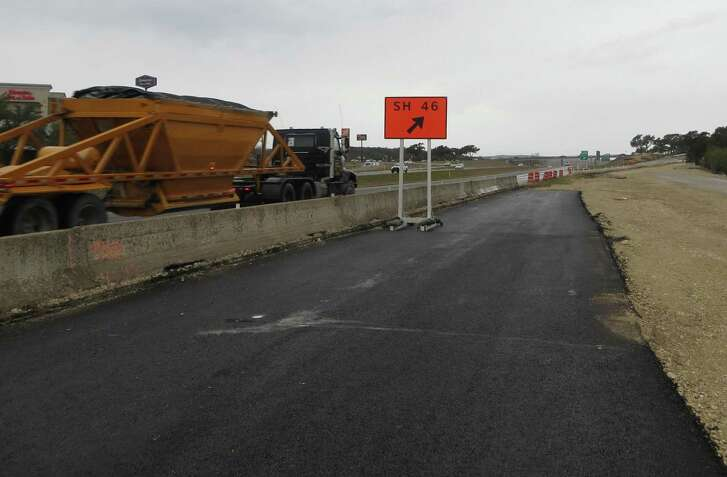 A truck headed west on Interstate 10 in Boerne on Tuesday 1-26-2016 passes the unfinished frontage road that the Texas Department of Transportation is building. In December the agency severed ties with Zimmerman Construction, which was supposed to finish the work in September, 2015, on the new westbound I-10 frontage road between U.S. 87 and Texas 46.