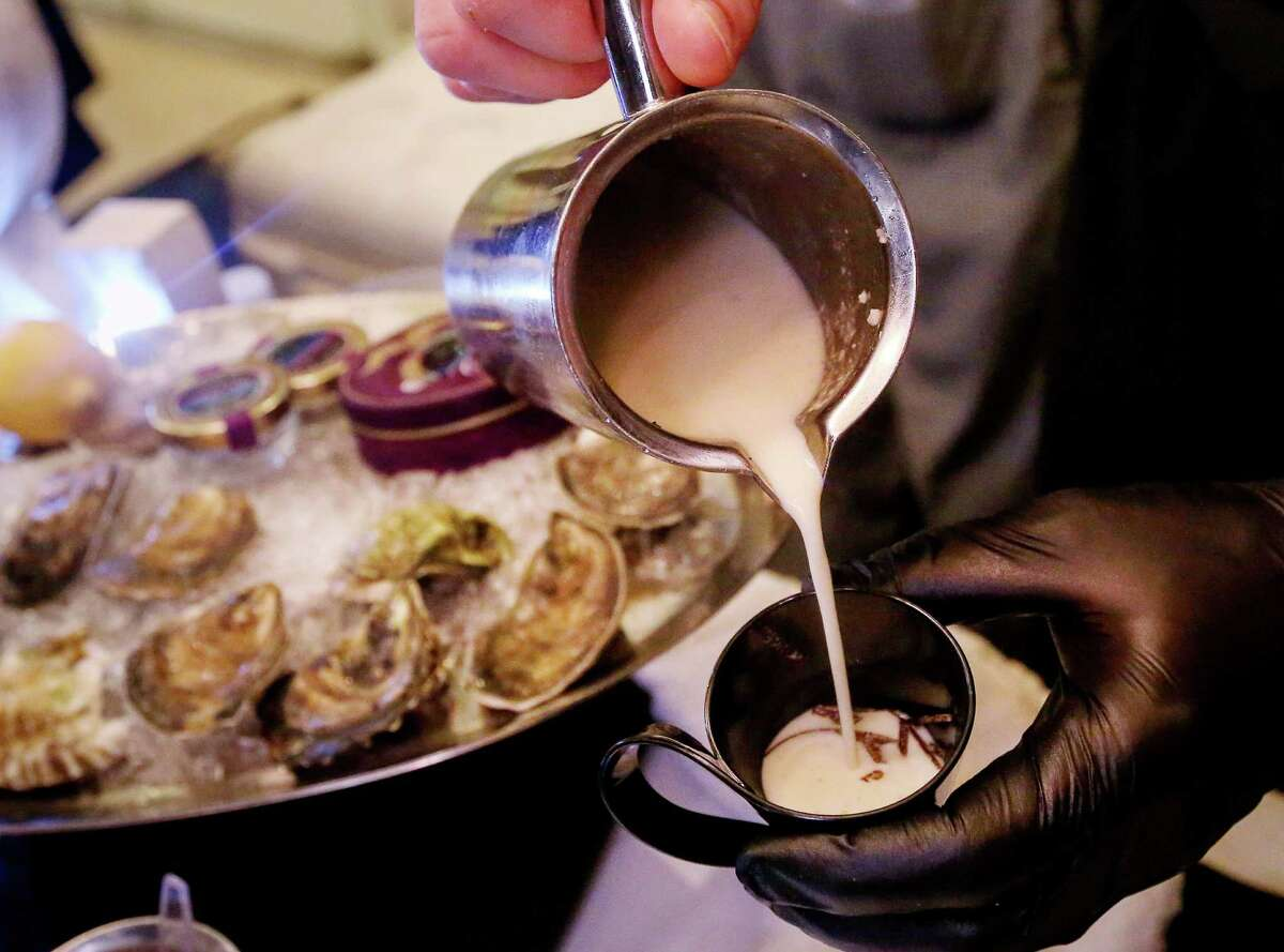 Cureight executive chef Austin Simmons took the People's Choice Award for his oyster and truffle potage.