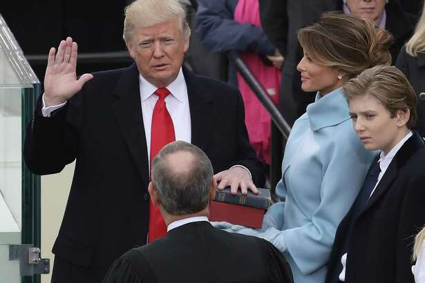 Supreme Court Justice John Roberts administers the oath of office to President Donald Trump as his wife Melania Trump holds the Bible and son Barron Trump looks on, on the West Front of the U.S. Capitol on Friday.