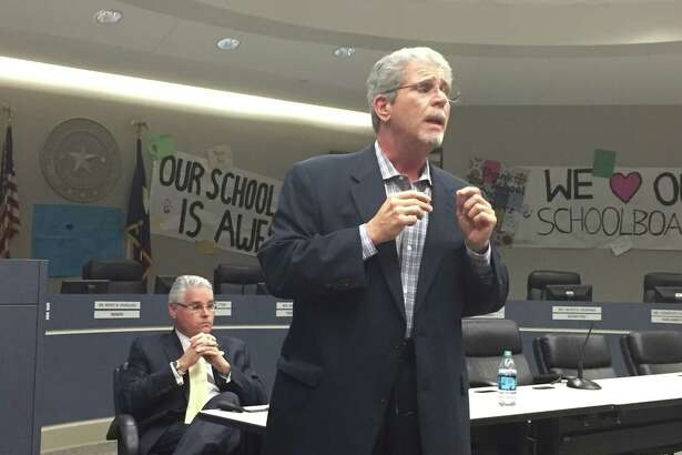 At left, State Rep. Dan Huberty listens as Guy Sconzo, executive director of the Fast Growth School Coalition addresses the crowd at Humble ISD's legislative committee meeting Thursday, Jan. 19.