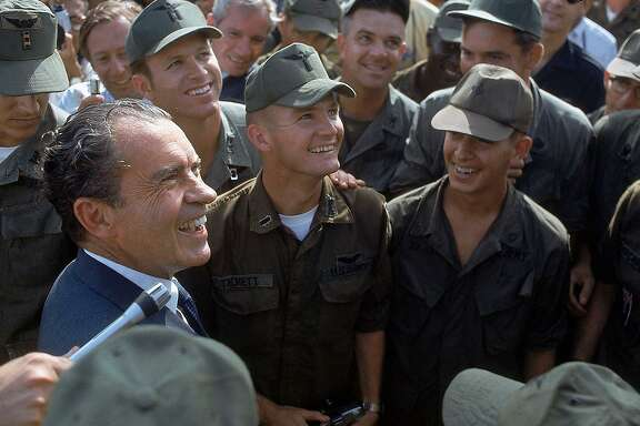 President Richard Nixon interfered in Lyndon Johnson's peace efforts in Vietnam for fear of handing the 1968 election to Hubert Humphrey. Was it treason? Here, he is shown mingling with crowd of U.S. soldiers during a surprise visit to the war zone in South Vietnam in 1969.