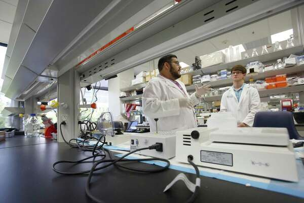 Scientific achievements in the city remain underappreciated but is home to The University of Texas Health Science Center and the Texas Biomedical Research Center. Researcher Jesus Segovia, left, demonstrates for Jacob Vosberg in August 2015 a technique for removing RNA from a solution after it has been put through a centrifuge process. Segovia is mentoring Vosberg as part of a five-year, $3.5 million grant from the National Institutes of Health (NIH) to the UTHSC.