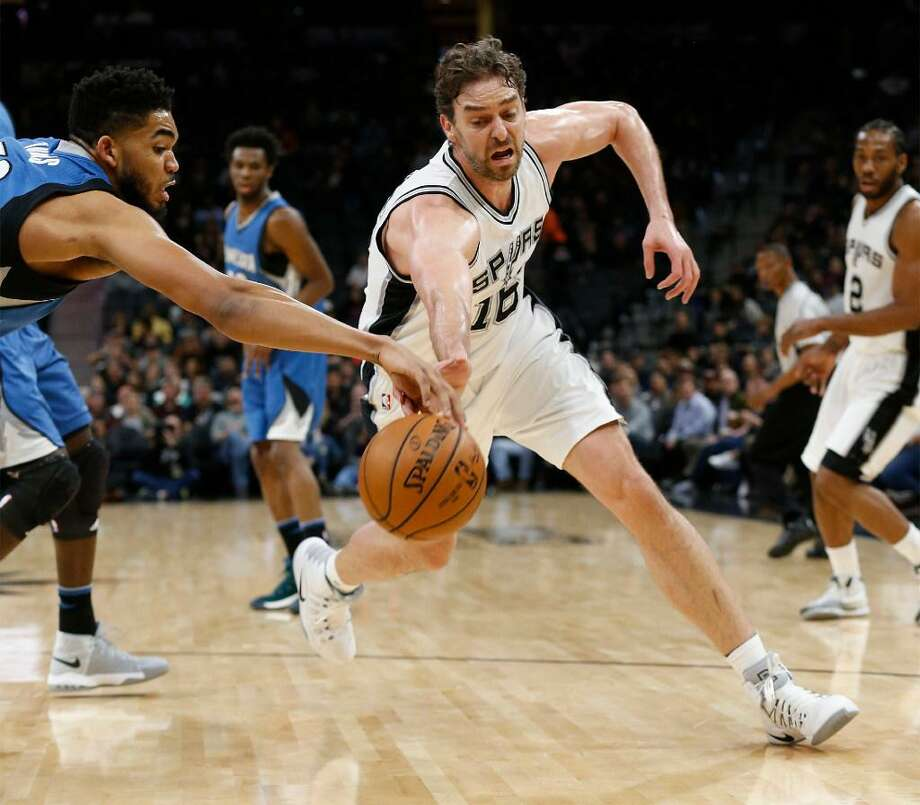 Spurs' Pau Gasol (16) fights for a loose ball against Minnesota Timberwolves' Karl-Anthony Towns (32) during their game at the AT&T Center on Tuesday, Jan. 17, 2017. Photo: Kin Man Hui /San Antonio Express-News