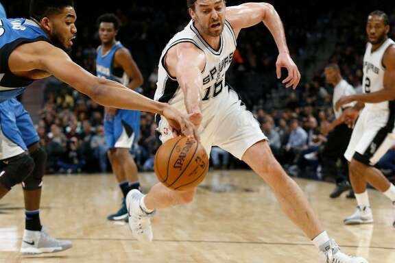 Spurs' Pau Gasol (16) fights for a loose ball against Minnesota Timberwolves' Karl-Anthony Towns (32) during their game at the AT&T Center on Tuesday, Jan. 17, 2017.