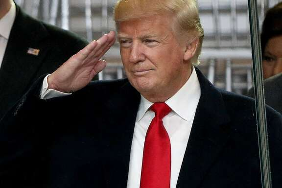 WASHINGTON, DC - JANUARY 20:  U.S. President Donald Trump salutes as he watches the Inaugural Parade from the main reviewing stand in front of the White House on January 20, 2017 in Washington, DC. Donald J. Trump was sworn in today as the 45th president of the United States.  (Photo by Patrick Smith/Getty Images)