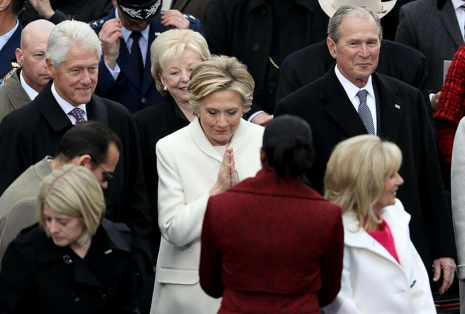 WASHINGTON, DC - JANUARY 20:  Former Democratic presidential nominee Hillary Clinton greets Michelle Obama as former President Bill Clinton and former President George W. Bush look on at the West Front of the U.S. Capitol on January 20, 2017 in Washington, DC. In today's inauguration ceremony Donald J. Trump becomes the 45th president of the United States.  (Photo by Joe Raedle/Getty Images) Photo: Joe Raedle, Getty Images