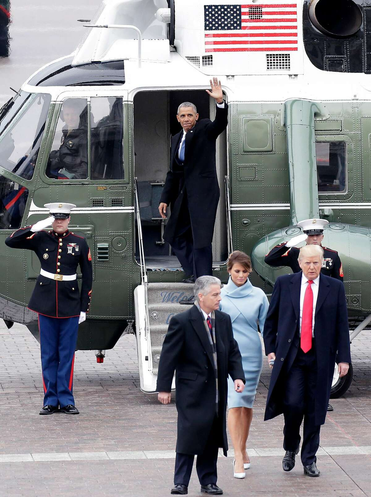 WASHINGTON, DC - JANUARY 20: Former President of the United States Barack Obama waves from a helicopter as newly elected United States President Donald Trump walks with wife Melania Trump back to the Capitol Building after Trump is sworn in at the 58th