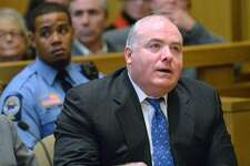 Michael Skakel reacts to being granted bail during his hearing at Stamford Superior Court, in Stamford, Conn., Thursday, Nov. 21, 2013. Skakel will be released on bail after receiving a new trial for the 1975 murder of his Greenwich, Conn., neighbor, Martha Moxley, which he was convicted of in 2002.