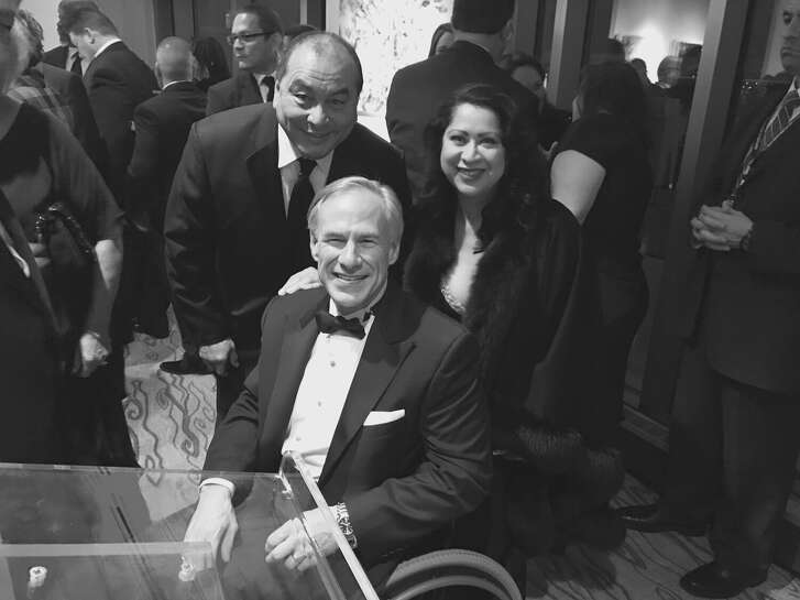 Texas Governor Greg Abbott (center) attended the Latino Inaugural Gala in Washington where his wife Cecilia Abbott, who is a Latina, was honored. Behind to the right, Laura Murillo, president of the Greater Houston Hispanic Chamber of Commerce and another person.