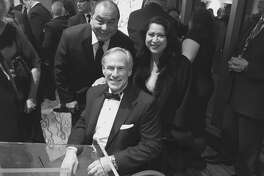 Texas Governor Greg Abbott (center) attended the Latino InauguralGala in Washington where his wife Cecilia Abbott, who is a Latina, was honored. Behind to the right, Laura Murillo, president of the Greater Houston Hispanic Chamber of Commerce and another person.