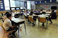 Teacher Deanna George teaches Religion to sixth-graders at  St. Joseph School  in Danbury Thursday, January 19, 2017.