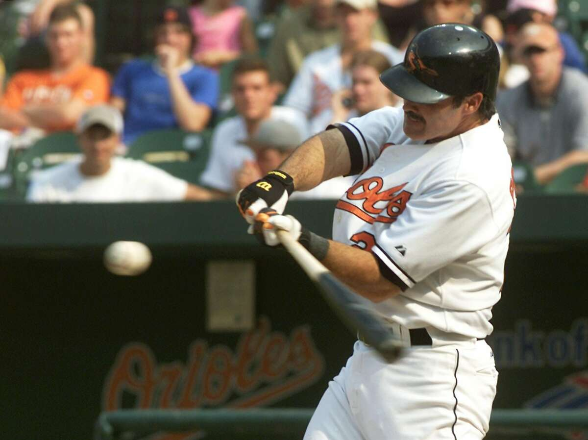 Baltimore Orioles batter Rafael Palmeiro swings at a pitch from Toronto Blue Jays relief pitcher Jason Frasor in the eighth inning of their game at Camden Yards in Baltimore, Maryland August 14, 2005. Palmeiro, who was playing in his first game since serving a 10-day suspension August 1 for failing a test for steroids, went hitless in four at bats with a walk as the Blue Jays defeated the Orioles 7-6. REUTERS/Joe Giza [Photo via NewsCom]