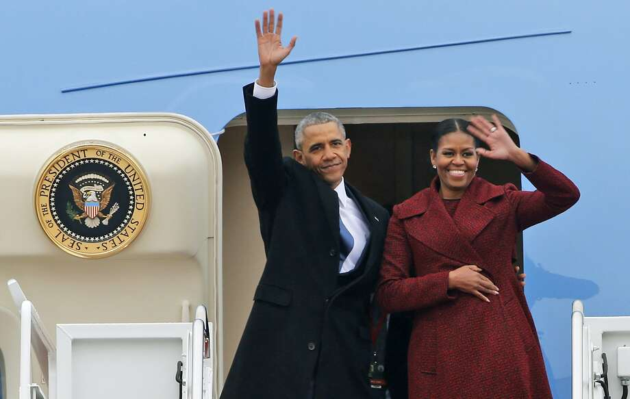 Former President Barack Obama and his wife Michelle wave to the crowd as they board an Air Force jet to depart Andrews Air Force base in Andrews Air Force Base, Md., Jan. 20. Photo: Steve Helber, Associated Press