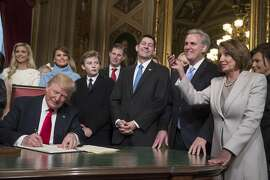 WASHINGTON, DC - JANUARY 20:  President Donald Trump is joined by the Congressional leadership and his family as he formally signs his cabinet nominations into law, in the President's Room of the Senate, at the Capitol in Washington, Friday, Jan. 20, 2017. From left behind Trump are, Ivanka Trump, Melania Trump, their son Barron Trump, Eric Trump, Speaker of the House Paul Ryan, (R-WI), Majority Leader Kevin McCarthy, (D-CA), and House Minority Leader Nancy Pelosi,(D-CA).  (Photo by J. Scott Applewhite - Pool/Getty Images)