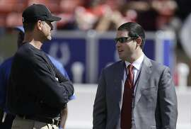 San Francisco 49ers head coach Jim Harbaugh, left, talks with owner Jed York before an NFL football game against the Indianapolis Colts in San Francisco, Sunday, Sept. 22, 2013. (AP Photo/Jeff Chiu)