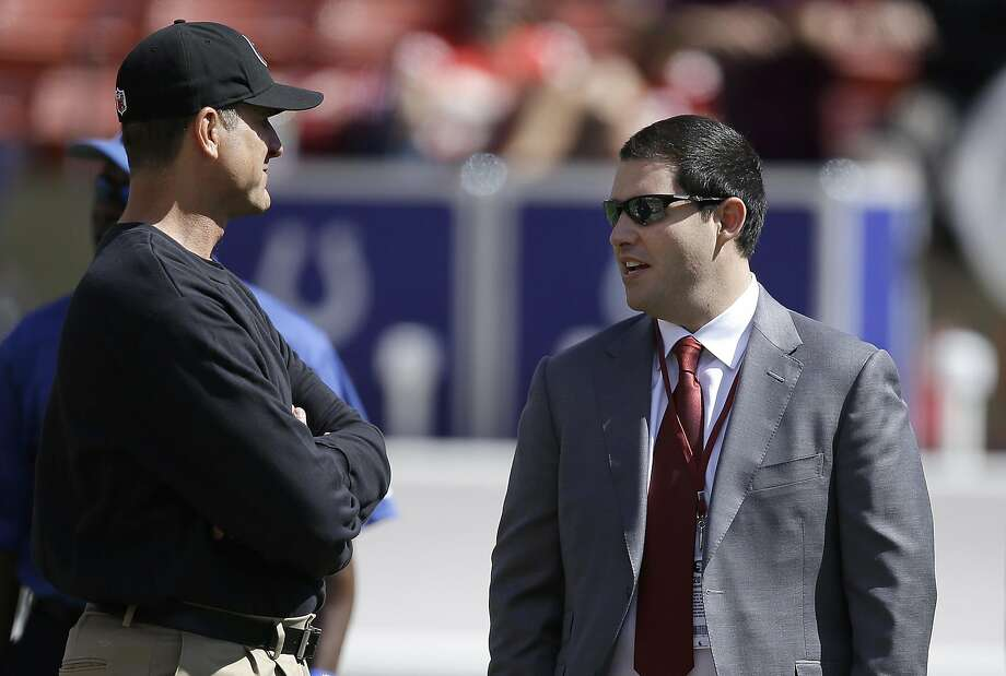 San Francisco 49ers head coach Jim Harbaugh, left, talks with owner Jed York before an NFL football game against the Indianapolis Colts in San Francisco, Sunday, Sept. 22, 2013. (AP Photo/Jeff Chiu) Photo: Jeff Chiu, Associated Press