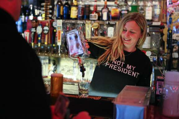 Bartender Meredith Newsom, wears an anti-trump shirt at Zeitgeist on Friday, January 20, 2017 in San Francisco, Calif.