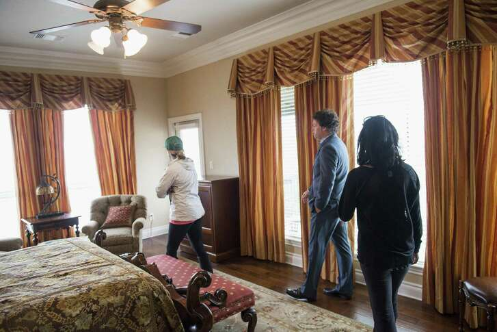 Matthew Gann (center), a real estate agent with Keller Williams, shows prospective homebuyers the bedroom of a house near Boerne. Buying a home for the first time is supposed to be fun, but it's actually hard work. You'll need to be surrounded by professionals who know what they are doing.