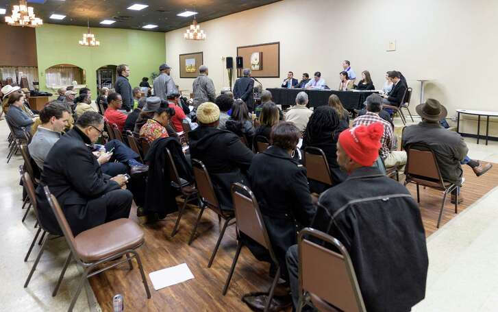 Fifth Ward residents line up to ask the panel questions during the Q&A session of the meeting over the proposed air permit for CemTech Concrete Ready Mix Inc. on Dec. 8, 2016, in Houston Texas.