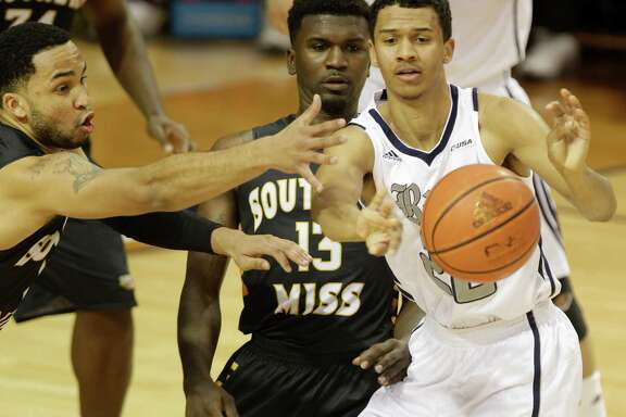 Rice University Marcus Jackson passes the ball ahead of  Southern Miss Rasham Suarez, left, and Chip Armelin during the second half of game at Rice University Thursday, Jan. 22, 2015, in Houston.   ( Melissa Phillip / Houston Chronicle )
