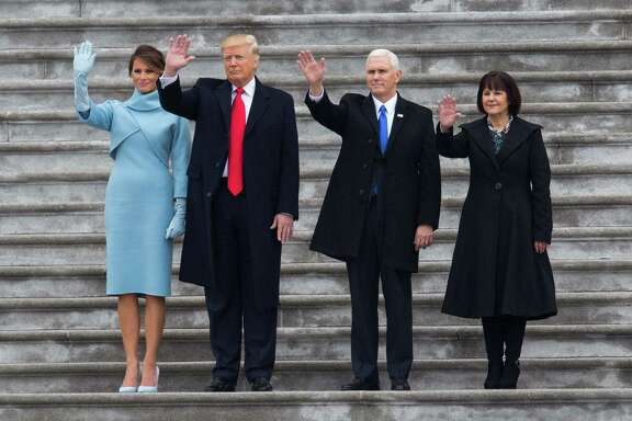 President Donald Trump and first lady Melania Trump with Vice President Mike Pence and Karen Pence wave goodbye to former President Barack Obama and Michelle Obama Friday.