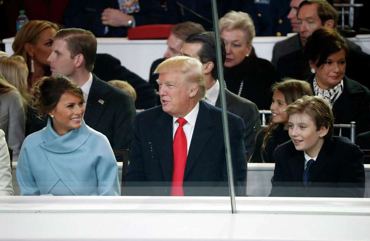 President Donald Trump watch with first lady Melania Trump and their son Barron during the 58th Presidential Inauguration parade for President Donald Trump in Washington. Friday, Jan. 20, 2017 (AP Photo/Pablo Martinez Monsivais)