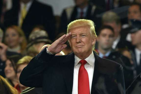 President Donald Trump salutes during the presidential inaugural parade  on Jan. 20, 2017 in Washington, D.C. (Nicholas Kamm/ AFP/Getty Images