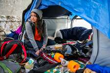 Kitty Limcaco sits in the tent that she shares with her boyfriend Jason Collins (not pictured) on Trainor Street in San Francisco, Calif., on Wednesday, January 11th, 2017.