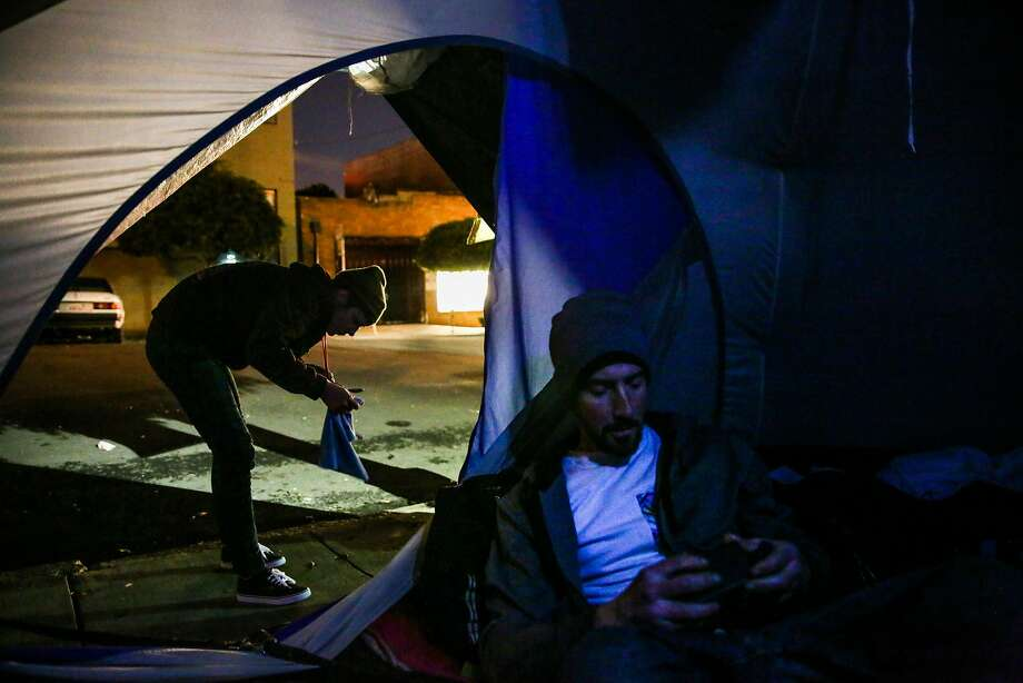 Homeless couple Hannah and Christopher Harnois get ready for the evening at their tent encampment on Utah Street in San Francisco. Photo: Gabrielle Lurie, The Chronicle