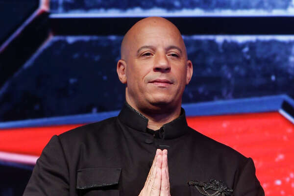 Hollywood actor Vin Diesel greets the gathering during a news conference to promote his film XXX: Return of Xander Cage in Mumbai, India, Thursday, Jan. 12, 2017  (AP Photo/Rafiq Maqbool) ORG XMIT: RMX110