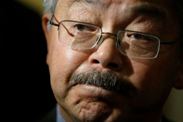 Mayor Ed Lee answers questions from news reporters about its sanctuary city policy, as he exits a Board of Supervisors meeting at City Hall, on Tuesday, Nov. 15, 2016 in San Francisco, Calif.