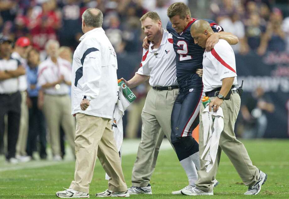 Houston Texans punter Brett Hartmann (2) is helped off the field after being injured during the fourth quarter of an NFL football game against the Atlanta Falcons at Reliant Stadium on Sunday, Dec. 4, 2011, in Houston. The Texans won the game 17-10.  ( Smiley N. Pool / Houston Chronicle ) Photo: Smiley N. Pool, Staff / © 2011  Houston Chronicle