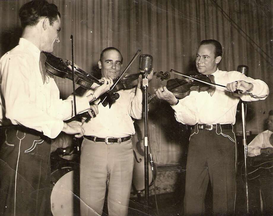 Southpaw fiddler Joe Holley, right, plays at a 1940s dance with legendary country music band leader Bob Wills, center, and his Texas Playboys. Photo: Courtesy Of The OKPopMuseum And Estate Of Bob Wills. / courtesy of the OKPopMuseum and Estate of Bob Wills.