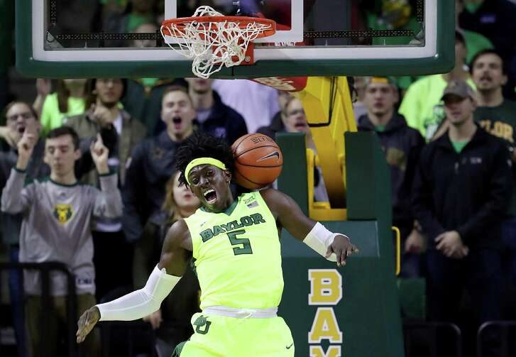 Johnathan Motley discovers the hazards of dunking. The junior is averaging 15.8 points for No. 6 Baylor.