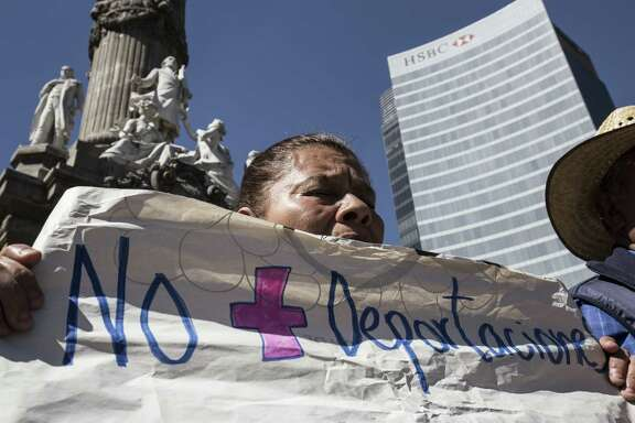 A demonstrator holds up a sign during a protest against U.S. President Donald Trump in Mexico City on Friday.
