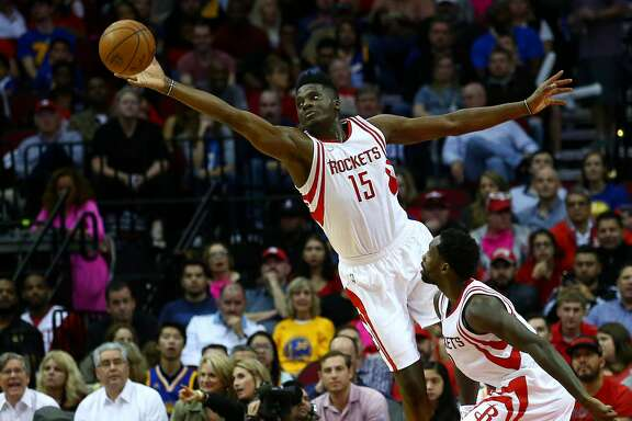 Houston Rockets center Clint Capela (15) misses a loose ball as guard Patrick Beverley (2) watches during the second quarter of an NBA game at the Toyota Center Friday, Jan. 20, 2017, in Houston. ( Jon Shapley / Houston Chronicle )