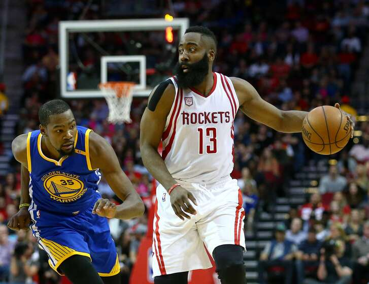 Houston Rockets guard James Harden (13) moves the ball downcourt while defended by Golden State Warriors forward Kevin Durant (35) during the second quarter of an NBA game at the Toyota Center Friday, Jan. 20, 2017, in Houston. ( Jon Shapley / Houston Chronicle )