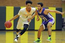 Trinity Stephon McGill drives past Westhill Jared Yaghoubian in a FCIAC intercity boys basketball game at Trinity Catholic High School's Walsh Court in Stamford, Conn. on Jan. 20, 2017.
