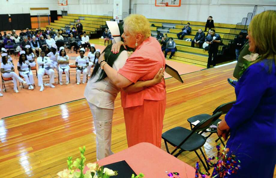Karen Ivers, LPN (Licensed Practical Nursing) Department Head, hugs graduate and CLass Valedictorian Sonam Verma duing the Class of 2017 LPN Program Graduation held at Bullard Havens High School in Bridgeport, Conn., on Friday June 20, 2017. Ivers, an instructor and program department head, has been with the program for more than 30 years at Bullard Havens and is retiring. This is also one of the final graduating classes of LPN's in the state run program. Photo: Christian Abraham / Hearst Connecticut Media / Connecticut Post