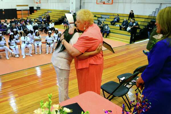 Karen Ivers, LPN (Licensed Practical Nursing) Department Head, hugs graduate and CLass Valedictorian Sonam Verma duing the Class of 2017 LPN Program Graduation held at Bullard Havens High School in Bridgeport, Conn., on Friday June 20, 2017. Ivers, an instructor and program department head, has been with the program for more than 30 years at Bullard Havens and is retiring. This is also one of the final graduating classes of LPN's in the state run program.