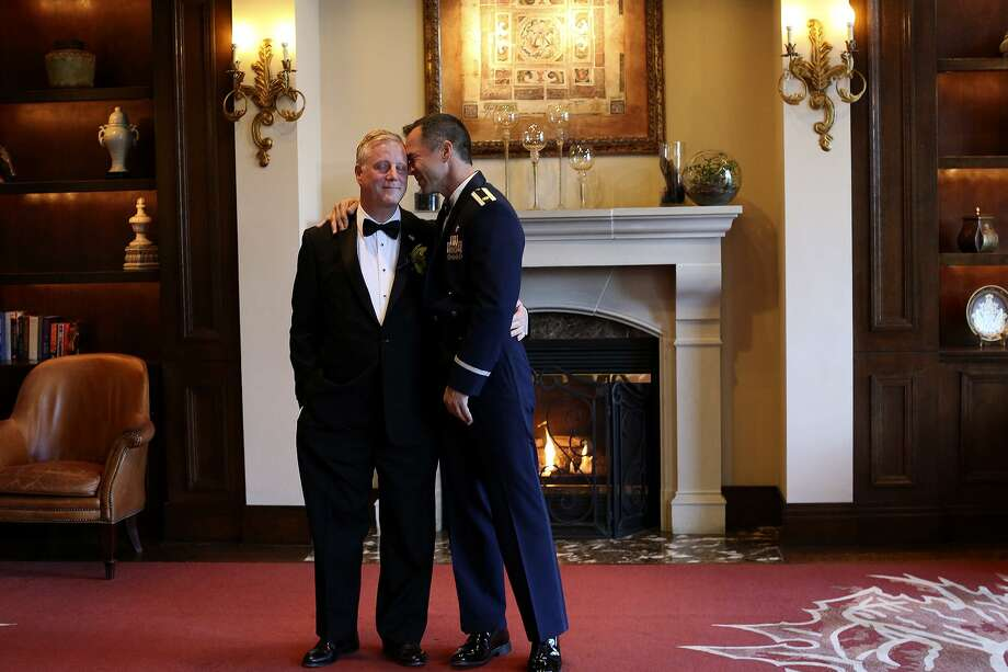 Mark Phariss, left, and Vic Holmes share a moment before they begin group photos with family and friends before their wedding in Frisco on Saturday, Nov. 21, 2015. Photo: Lisa Krantz, STAFF / SAN ANTONIO EXPRESS-NEWS / SAN ANTONIO EXPRESS-NEWS