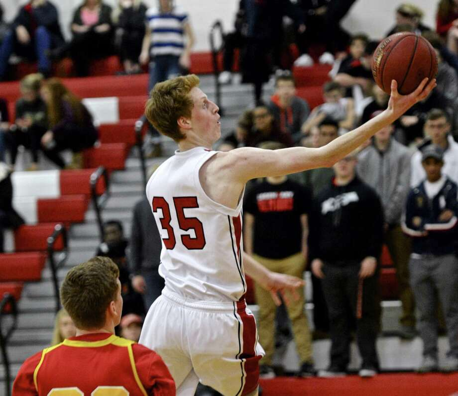 Pomperaug's Joshua McGettigan (35) drives past Stratford's Connor Anstis (30) in the boys high school basketball game between Stratford and Pomperaug high schools, on Friday night, January 20, 2017, at Pomperaug High School, in Southbury, Conn. Photo: H John Voorhees III / Hearst Connecticut Media / The News-Times